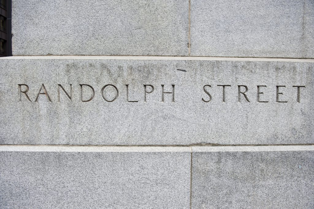 Name of Randolph Street carved on a concrete stone wall at Randolph street for people's convenience in Chicago, Illinois. The color of the wall in the picture is white.