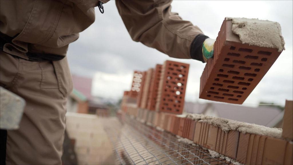 building a house with bricks