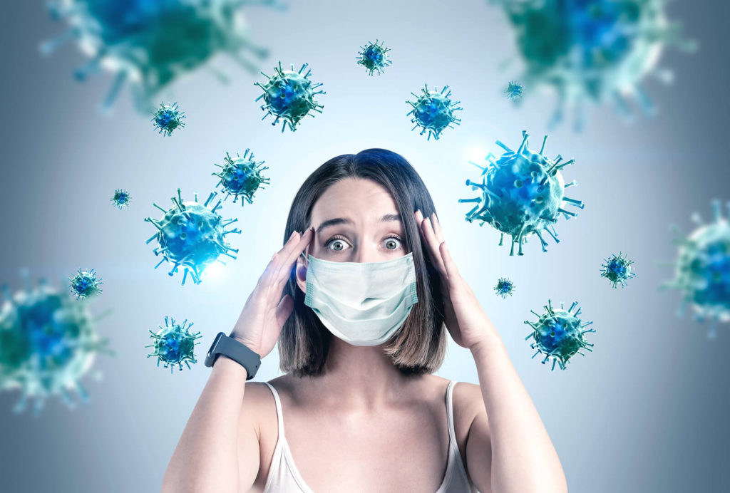 woman with mask and virus in the ari
